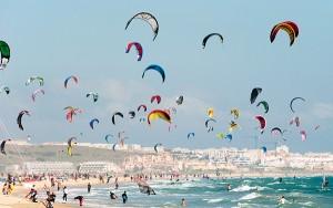 Kite Surfing On Dos Mares Beach In Front Of Hotel Dos Mares; Tarifa, Costa De La Luz, Andalusia, Spain