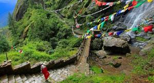1-slide-bhutan-trek-forest-path-prayer-flags-pano1