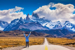 argentina-patagonia-woman-delighted-natural-beauty-raised-her-hands.-the-highway-leads-to-the-snow-capped-peaks-of-mount-fitzroy1